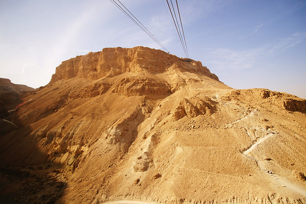 Masada Israel travel high resolution photos 2010; Masada מצדה is the name for a site of ancient palaces and fortifications in the South District of Israel on top of an isolated rock plateau, or horst, on the eastern edge of the Judean Desert over